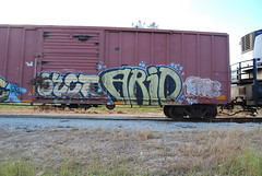 Arid (Stalkin The Lines) Tags: art cars car metal yard train graffiti paint florida steel trains spray parked fl spraypaint graff arid freight railcars trainyard southflorida freights trainart 1000000 benched benching 1000000railcars
