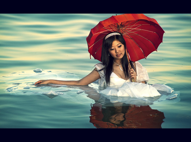 Floating Girl with Red Umbrella