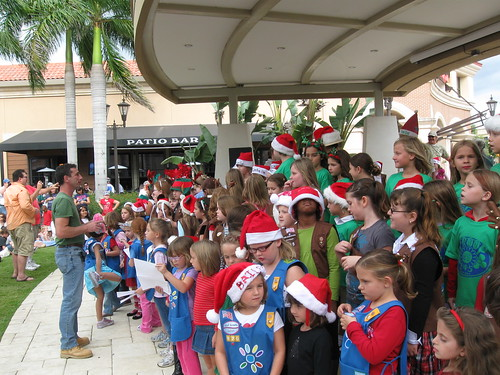 Girl Scouts sing and donate toys in Ft Myers