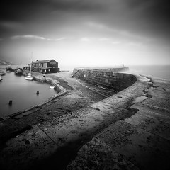 The Cobb (Andy Brown (mrbuk1)) Tags: ocean longexposure cloud seascape wall boats aquarium mono blackwhite fishing harbour s textures coastal dorset vignette serpentine lymeregis seadefence jurassiccoast nd110
