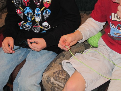 Priceless watching their little hands with the crochet hooks!