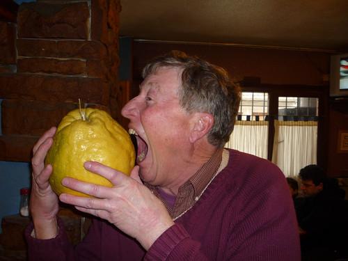 Paul bites a giant lemon