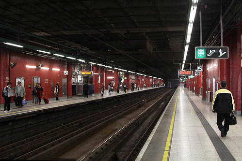 Train driver walks to the other end of the platform at Tsuen Wan
