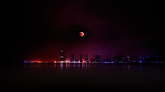 The 2010 Winter Solstice Lunar Eclipse over Jersey City, NJ (mudpig) Tags: nyc newyorkcity longexposure winter moon ny newyork reflection skyline night reflections geotagged eclipse newjersey jerseycity