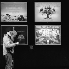Another Year.. (Ian Brumpton) Tags: street blackandwhite bw blancoynegro monochrome square blackwhite noiretblanc candid citylife londres leicestersquare wallstreet princecharlescinema sidewalkstories anotheryear londonstreetphotography lifeinslowmotion scattidistrada moneyneversleeps ianbrumpton aimlessstrolling londonatlarge lifeoneasystreet