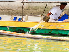 Man Power (Jo Mari Montesa) Tags: wood travel house fish man net nature water digital rural canon river lens asian photography eos boat photo wooden fishing kiss asia village power fishermen philippines islander bulacan rivers housing catch province asean x4 fishingvillage islande bangka obando manpower fishernan 550d baklad