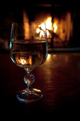 By The Fireside (oh diggity) Tags: fire fireplace holidays dof wine bokeh naturallight lowkey d90 moscato sigma1750mmf28exdcoshsm