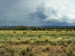 Landscape Between Espanola and Taos, New Mexico (JIMWICh) Tags: road trip vacation newmexico southwest honda landscape desert sightseeing scenic adventure riding journey solo motorcycle paloalto taos stormclouds vfr espanola darkskies jimwich