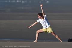 Girl doing exercises on Morro Strand State Beach