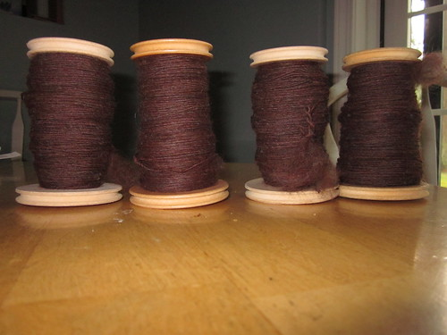 Four bobbins, ready to ply