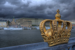 Palace and the Crown (Henrik Sundholm.) Tags: wood bridge sky storm castle church boats golden harbor cross wind sweden stockholm rail palace ornament crown sverige nicolai hdr monarchy sankt kyrka strmmen storkyrkan slottet skeppsholmsbron