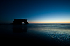 As the sun goes down (Penelope's Loom) Tags: ocean longexposure blue sunset orange santacruz beach water twilight nikon arch sundown naturalbridges d700 1424mm28