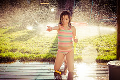 soap bubbles and sprinklers (lermaniac) Tags: sprinkler  backlight girl wet water sunflare