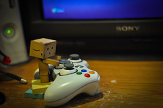 day 8- Danbo finds the xbox (Pat_Landor) Tags: 50mm xbox 360 f18 controller danbo motleypixel