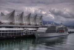 Canada Place (HDR) (Brandon Godfrey) Tags: city cruise vacation urban holiday canada mountains detail reflection water vancouver clouds photoshop reflections landscape outdoors photography harbor dock scenery day ship cityscape bc metro cloudy outdoor britishcolumbia sony details north sails scenic overcast icon canadian sharp shore western pacificnorthwest metropolis northvancouver van alpha dslr iconic canadaplace hdr highdynamicrange coalharbour destinations lowermainland northshoremountains a300 tonemapped tonemapping cs5 photomatixpro4