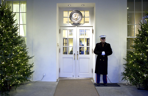 A Marine Sentry stands guard outside the West Wing entrance of the White House