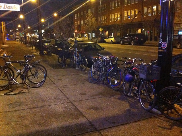 Bikes parked last night. More across the street and to the right of the photo.