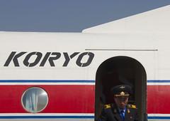 Air Koryo plane in Samjiyon airport, North Korea (Eric Lafforgue) Tags: people color colour horizontal plane person airport war asia korea communism asie coree aeroport personne couleur humanbeing communisme avion nor