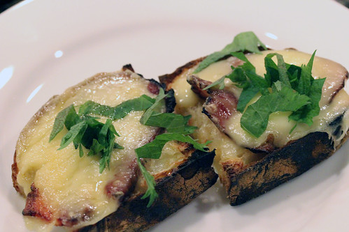 Two bacons with raclette on toast with shiso