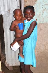 Baby with Porridge Cup (cowyeow) Tags: africa street baby girl children child african littlegirl uganda schoolgirl kasese