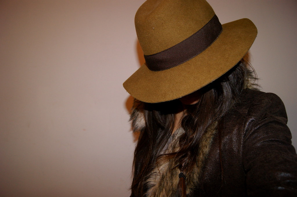 hat messy braid and fur collar