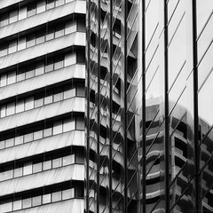 Mathematical Chaos (Between Pirie and Grenfell Streets) (michelle-robinson.com) Tags: details 4tografie southaustralia fujifilm exterior adelaide australia blackandwhite lines angles lookingup monochrome bw abstract michmutters michellerobinson instagram architecture xt10 buildings reflections windows modern order