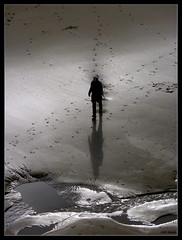 You Never Walk Alone (LiesBaas) Tags: woman beach water by strand puddle nice sand funny pretty alone all view arms scheveningen denhaag human hoody mens footsteps lonely mooi uitzicht beanie thehague vrouw armen zand alleen muts benen leggs herself voetstappen colourphotography geintje grapje schitteringen kleurenfotografie liesbaas walkingstraitintothelakeofperditionbyliesbaas rechtopdepoeldesverderfsaflopenbyliesbaas youneverwalkalonebyliesbaas
