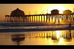 golden beach sunset (Eric 5D Mark III) Tags: ocean california sunset shadow people seascape reflection beach silhouette canon landscape golden pier surf walk surfer wave rays orangecounty huntingtonbeach tone ef24105mmf4lisusm eos5dmarkii