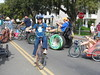 Whymcycles riding round and round at parade start ...2 (RussellR) Tags: bike bicycle bici bigwheel bicyclette ingo amphibious hoosier kineticsculpturerace ksr bounceforglory aquabike amphibiousbicycle quadracycle whymcycle visualizewhirledpeas buckingforglory