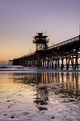The Watchtower (Didenze) Tags: california blue sky orange texture beach reflections lights pier twilight raw glow purple perspective pebbles explore pacificocean lowtide sanclemente watchtower lightreflections sanclementepier canonrebelxsi exposurefusion didenze