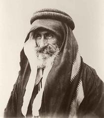 Portrait of Sheikh Khalil Senaah (against a wall background) at Kerak. (Palestine Exploration Fund) Tags: portrait man costume arab kerak gelatin hornstein transjordan PEF:Photo=p2364 18951899