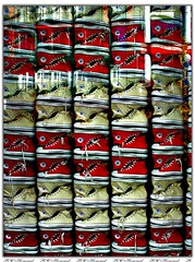 Converse (fotophriendly) Tags: nyc newyorkcity red white yellow composition reflections fun vivid sneakers converse windowdisplay quirky watermark canong6 linedup converseallstars allinarow ©allrightsreserved heartawards thebestofday gününeniyisi fotophriendly doubledragonawards artofimages thebestvisions flickrunitedaward rchommel ☮❤♪ sceamotthephotographer