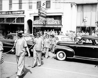 ILGWU demonstration, women dressed in prison-stripe costumes, carrying chains