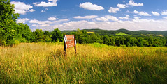 Midsummer (Nicholas_T) Tags: summer sky field sign clouds rural landscape newjersey hiking meadow hills brightlight cumulus creativecommons greatvalley warrencounty whitetownship beaverbrookwildlifemanagementarea