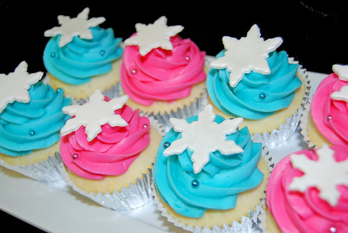 Pink and Aqua Snowflake Topped Cupcakes for a Winter Wonderland Birthday Party