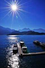 Blue pier in the morning (Vincent_Ting) Tags: sky nature water pier boat nikon taiwan explore   gettyimages crepuscularrays    runrise       vincentting
