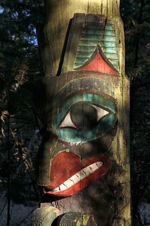 bear figure of a memorial totem pole, Totems Historic District, Kasaan, Alaska