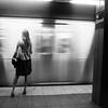 Vanishing Lady (Airicsson) Tags: street new york city nyc summer urban blackandwhite bw woman usa white ny motion black lady train subway island lumix us walk manhattan panasonic mta unionsquare 2010 streetshot lx3