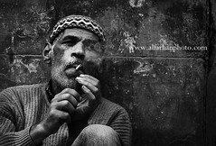 smoking man (SAAD AL_FARHAN) Tags: life road street bw man nikon live poor smoking cairo saad    eygpt 70200mm                d3s  alfarhan