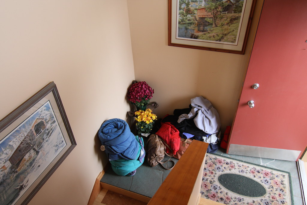 Entryway with sleeping bags and backpacks