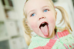 funny morning (AntjeEgbert) Tags: blue portrait girl tongue laughing kid eyes funny child faces kind lustig laugh augen pigtails lachen making mdchen zunge blaue grimassen lachend zpfe