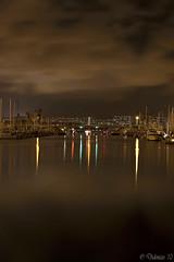 Night at the Harbor (Didenze) Tags: california longexposure bridge vertical night marina reflections boats lights perspective explore cloudreflections lightreflections danapointharbor smoothwater citilights canonrebelxsi didenze