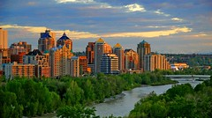 Skyline oversaturated (Una S) Tags: city sunset summer canada calgary skyline river evening downtown cloudy centre alberta bow