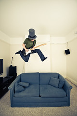 Flash (jæms) Tags: music selfportrait man me rock jump guitar air couch sofa remoteflash remoteshutter