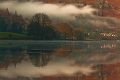 Mist clearing over Grasmere (Steve Thompson images) Tags: autumn trees mist lake mountains reflection water village grasmere lakedistrict cumbria canon70200l grasmerelake ndgrad nwengland