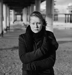 Elisa (GreggBK) Tags: light portrait blackandwhite woman beach netherlands female 50mm model nikon ambient f18 thehague d700 scheveningenpier