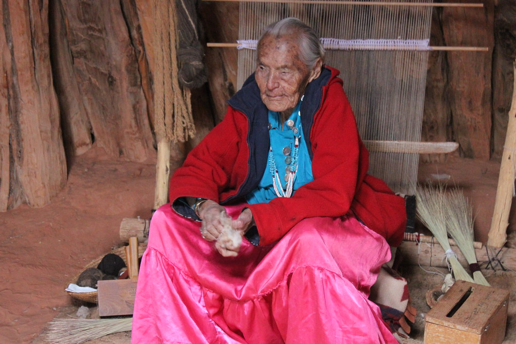A 96 year old woman demonstrating how to clean wool in Monument Valley