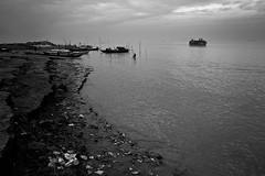 পদ্মাপাড় (Kazi Ashraful Alam) Tags: sky people bw white black water river boat kiss bank pollution 1750 grayscale tamron bangladesh x4 padma mawa maoa maowa