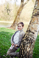 8 Years Old (Kidzmom2009) Tags: trees boy portrait france cute nature childhood smiling outdoors happy handsome 8years eightyearsold leaningonatree gettyimageswant europeanpark kidzmom2009 gettyimageswants gettywants familygetty2010 kfsphotography gettyimagesfranceq1
