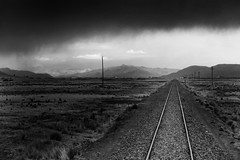 Railroad (pantha29) Tags: railroad blackandwhite peru lines grey vanishingpoint track moody cloudy monotone andes railtrack darkskies trainline andeanexpress